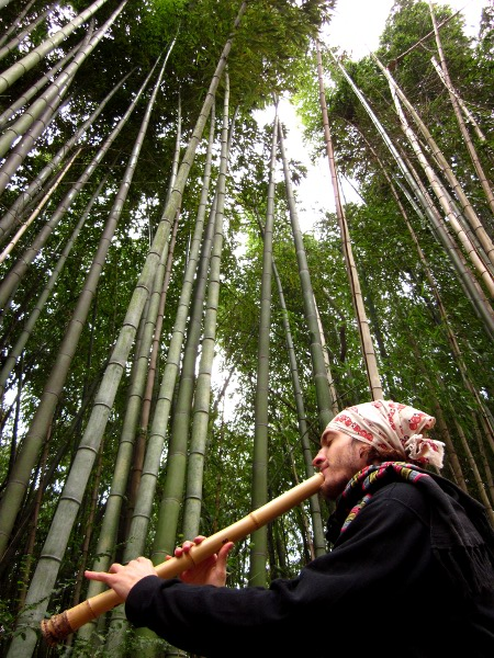 Jon Kypros playing shakuhachi at a madake bamboo grove, 2010.